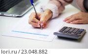 Купить «businesswoman with laptop, calculator and papers», видеоролик № 23048882, снято 18 марта 2016 г. (c) Syda Productions / Фотобанк Лори