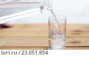 Купить «water pouring into glass on wooden table», видеоролик № 23051854, снято 2 апреля 2016 г. (c) Syda Productions / Фотобанк Лори