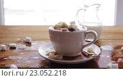 Купить «coffee cup full of lump sugar on wooden table», видеоролик № 23052218, снято 15 апреля 2016 г. (c) Syda Productions / Фотобанк Лори