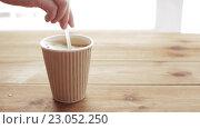 Купить «hand adding and stirring sugar in cup of coffee», видеоролик № 23052250, снято 15 апреля 2016 г. (c) Syda Productions / Фотобанк Лори