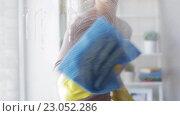 Купить «woman in gloves cleaning window with rag», видеоролик № 23052286, снято 17 апреля 2016 г. (c) Syda Productions / Фотобанк Лори