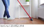 Купить «woman with broom cleaning floor at home», видеоролик № 23052314, снято 17 апреля 2016 г. (c) Syda Productions / Фотобанк Лори