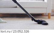 Купить «woman with vacuum cleaner cleaning carpet at home», видеоролик № 23052326, снято 17 апреля 2016 г. (c) Syda Productions / Фотобанк Лори