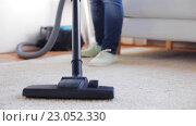 Купить «woman with vacuum cleaner cleaning carpet at home», видеоролик № 23052330, снято 17 апреля 2016 г. (c) Syda Productions / Фотобанк Лори