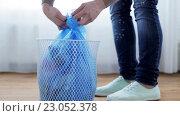 Купить «woman tying bag with garbage in waste bin», видеоролик № 23052378, снято 23 апреля 2016 г. (c) Syda Productions / Фотобанк Лори