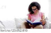 Купить «african american young woman reading book at home», видеоролик № 23052810, снято 7 мая 2016 г. (c) Syda Productions / Фотобанк Лори