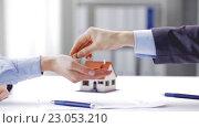 Купить «business partners with house keys and contract», видеоролик № 23053210, снято 15 мая 2016 г. (c) Syda Productions / Фотобанк Лори