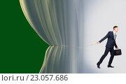 Купить «Young businessman beginning presentation, concept of performance», фото № 23057686, снято 11 мая 2016 г. (c) Владимир Мельников / Фотобанк Лори