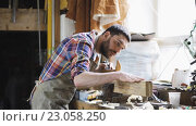 Купить «carpenter working with plane and wood at workshop», видеоролик № 23058250, снято 21 мая 2016 г. (c) Syda Productions / Фотобанк Лори