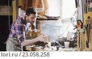 Купить «carpenter working with plane and wood at workshop», видеоролик № 23058258, снято 21 мая 2016 г. (c) Syda Productions / Фотобанк Лори
