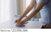 Купить «pregnant woman folding baby boys clothes at home 26», видеоролик № 23058386, снято 28 мая 2016 г. (c) Syda Productions / Фотобанк Лори