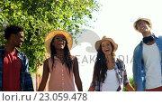 Купить «Hipsters are holding by hand and walking in the street », видеоролик № 23059478, снято 19 августа 2019 г. (c) Wavebreak Media / Фотобанк Лори