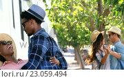 Купить «Young hipsters are dancing in the street », видеоролик № 23059494, снято 19 августа 2019 г. (c) Wavebreak Media / Фотобанк Лори