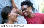 Купить «Young hipsters are laughing in the street », видеоролик № 23059502, снято 19 августа 2019 г. (c) Wavebreak Media / Фотобанк Лори