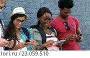 Купить «Young hipsters are using their smartphone », видеоролик № 23059510, снято 19 августа 2019 г. (c) Wavebreak Media / Фотобанк Лори