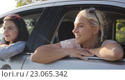 Купить «happy teenage girls or women in car at seaside 20», видеоролик № 23065342, снято 9 июня 2016 г. (c) Syda Productions / Фотобанк Лори