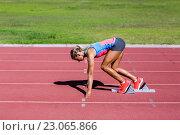 Купить «Female athlete ready to run on running track», фото № 23065866, снято 13 января 2016 г. (c) Wavebreak Media / Фотобанк Лори