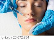 Купить «Woman receiving botox injection on her lips», фото № 23072854, снято 3 февраля 2016 г. (c) Wavebreak Media / Фотобанк Лори