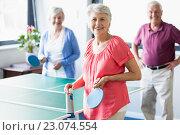 Купить «Seniors playing ping-pong», фото № 23074554, снято 2 марта 2016 г. (c) Wavebreak Media / Фотобанк Лори