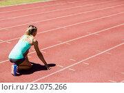 Купить «Female athlete ready to run on running track», фото № 23075266, снято 13 января 2016 г. (c) Wavebreak Media / Фотобанк Лори