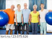 Купить «Seniors holding exercise ball and weights», фото № 23075626, снято 2 марта 2016 г. (c) Wavebreak Media / Фотобанк Лори