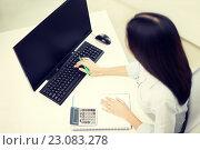 Купить «close up of woman with calculator counting», фото № 23083278, снято 6 ноября 2013 г. (c) Syda Productions / Фотобанк Лори