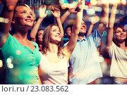 Купить «smiling friends at concert in club», фото № 23083562, снято 20 октября 2014 г. (c) Syda Productions / Фотобанк Лори