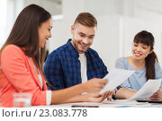 Купить «happy creative team or students working at office», фото № 23083778, снято 27 февраля 2016 г. (c) Syda Productions / Фотобанк Лори
