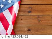 Купить «close up of american flag on wooden boards», фото № 23084462, снято 6 мая 2016 г. (c) Syda Productions / Фотобанк Лори