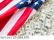 Купить «close up of american flag and dollar cash money», фото № 23084470, снято 6 мая 2016 г. (c) Syda Productions / Фотобанк Лори