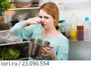 Купить «woman noticed foul smell of food from casserole», фото № 23090554, снято 20 апреля 2018 г. (c) Яков Филимонов / Фотобанк Лори