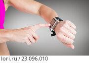 Купить «Composite image of female athlete using her smart watch», фото № 23096010, снято 22 октября 2018 г. (c) Wavebreak Media / Фотобанк Лори