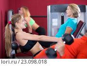 Купить «Adult people having strength training in gym», фото № 23098018, снято 21 апреля 2019 г. (c) Яков Филимонов / Фотобанк Лори