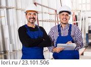 Купить «Mechanical engineer inspecting the work of labour at factory», фото № 23101506, снято 17 августа 2018 г. (c) Яков Филимонов / Фотобанк Лори