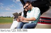 Купить «happy couple with tablet pc at hatchback car trunk 32», видеоролик № 23105986, снято 15 июня 2016 г. (c) Syda Productions / Фотобанк Лори