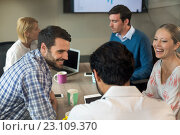 Купить «Business people interacting during a meeting», фото № 23109370, снято 20 марта 2016 г. (c) Wavebreak Media / Фотобанк Лори