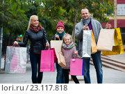 Купить «Family couple with kids on city street», фото № 23117818, снято 22 ноября 2018 г. (c) Яков Филимонов / Фотобанк Лори
