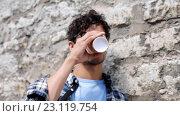 Купить «man in eyeglasses drinking coffee over street wall 21», видеоролик № 23119754, снято 16 июня 2016 г. (c) Syda Productions / Фотобанк Лори