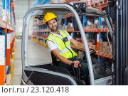 Купить «Portrait of worker is smiling and posing during work», фото № 23120418, снято 23 марта 2016 г. (c) Wavebreak Media / Фотобанк Лори