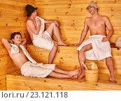Male company in hat relaxing at sauna. Стоковое фото, фотограф Gennadiy Poznyakov / Фотобанк Лори