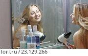 Купить «girl drying her hair», видеоролик № 23129266, снято 14 мая 2016 г. (c) Яков Филимонов / Фотобанк Лори