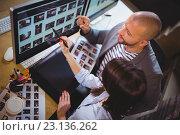 Купить «Coworkers discussing over computer at desk», фото № 23136262, снято 10 апреля 2016 г. (c) Wavebreak Media / Фотобанк Лори