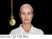 Купить «Senior woman being hypnotized with pendulu», фото № 23136562, снято 5 апреля 2016 г. (c) Wavebreak Media / Фотобанк Лори