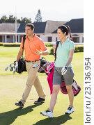 Купить «Full length of couple carrying golf bags», фото № 23136954, снято 14 апреля 2016 г. (c) Wavebreak Media / Фотобанк Лори