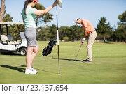 Купить «Couple playing golf together», фото № 23137654, снято 14 апреля 2016 г. (c) Wavebreak Media / Фотобанк Лори