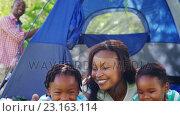 Купить «Woman posing lying with her children», видеоролик № 23163114, снято 17 июля 2019 г. (c) Wavebreak Media / Фотобанк Лори