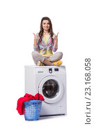 Купить «Woman tired after doing laundry isolated on white», фото № 23168058, снято 16 мая 2016 г. (c) Elnur / Фотобанк Лори