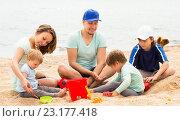 Купить «Happy family with kids having a rest», фото № 23177418, снято 17 мая 2014 г. (c) Яков Филимонов / Фотобанк Лори