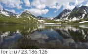 Купить «Time lapse: горы, их отражение в озере и плывущие облака по синему небу. Камчатка», видеоролик № 23186126, снято 21 июня 2016 г. (c) А. А. Пирагис / Фотобанк Лори