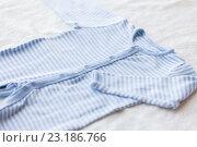 Купить «close up of baby bodysuit for newborn boy on towel», фото № 23186766, снято 25 мая 2016 г. (c) Syda Productions / Фотобанк Лори